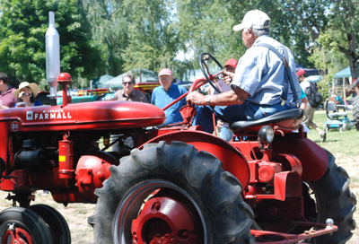 still driving his old tractor